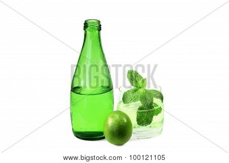 Bottle And Glass Of Sparkling Mineral Water With Lime And Melissa
