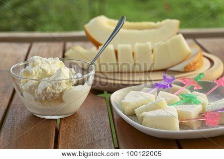 Slices Of Melon And Ice Cream