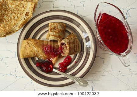 Pancakes With Red Currant Jam On Crockery Plate