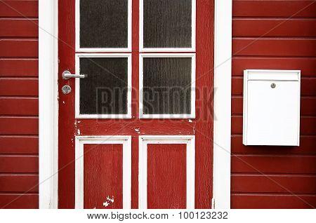 Red door with mailbox