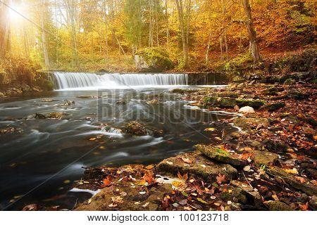 waterfall with a shining sun