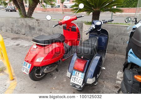 Classic Vespa Scooters Stands Parked On A Roadside