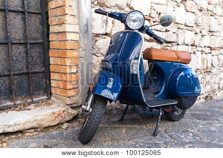 Classic Blue Vespa Px 150 Scooter Stands Parked