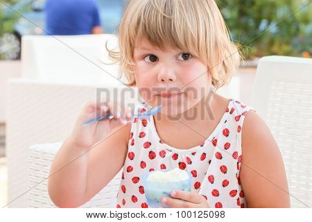 Blond Caucasian Baby Girl Eats Frozen Yogurt