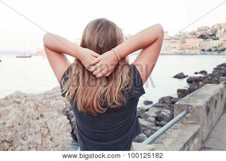 Blond Caucasian Teenage Girl Standing On Seacoast