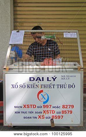 man sells lottery tickets on street in Hanoi