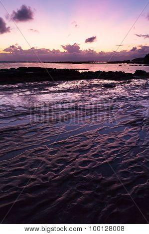 Beautiful rock patterns and sunrise at shore