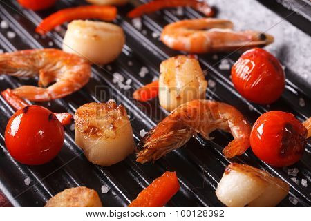 Scallops And Shrimp Are Fried On The Grill Close Up. Horizontal