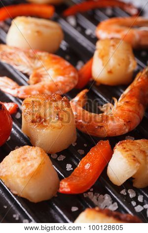 Scallops, Shrimp And Vegetables On Grill Macro. Vertical