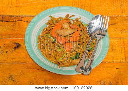 fried noodle on wooden background