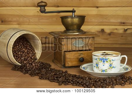 Time for a good aromatic coffee. Coffee on a wooden table. Preparing for home drinking coffee.