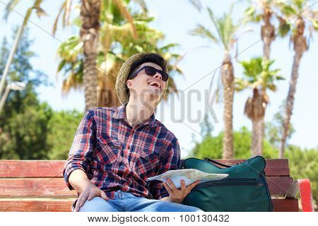 Cheerful Travel Man Laughing Outside With Map And Bag