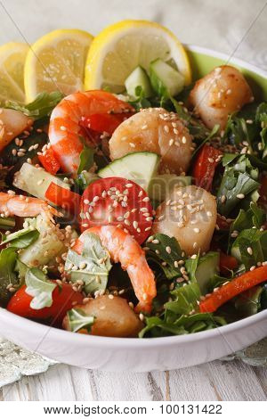 Salad With Shrimp, Scallops And Fresh Vegetables Close Up. Vertical