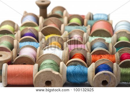 thread for sewing on wooden spools, needlework