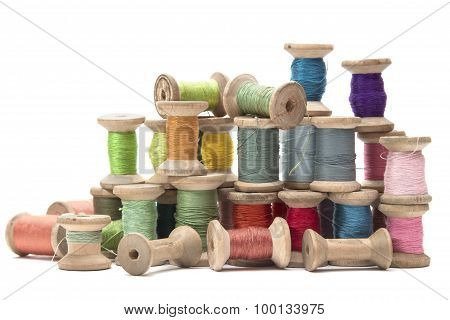 wooden spools with colored cotton threads for sewing vintage