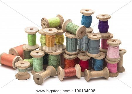 set of colored thread for sewing on wooden spools, vintage