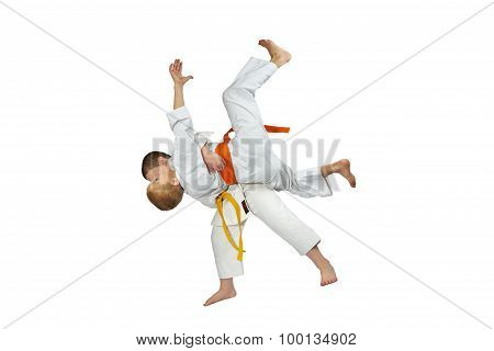 Two athletes in judogi are doing throws judo