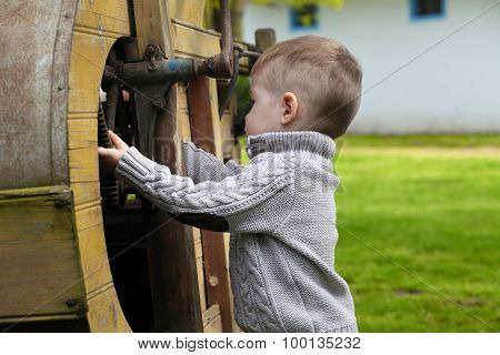 2 Years Old Curious Baby Boy Managing With Old Agricultural Mach