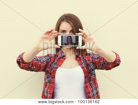 Pretty Girl Makes Self-portrait On The Smartphone Outdoors In The City, Screen View