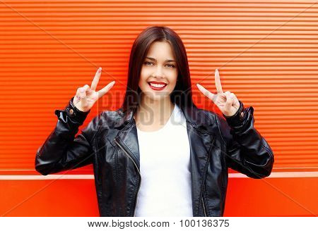 Fashion Portrait Of Beautiful Cool Smiling Woman Wearing A Rock Black Leather Jacket Having Fun Agai