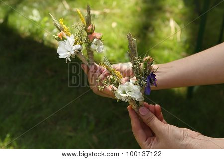 Forest Wedding Boutonnieres In Hands