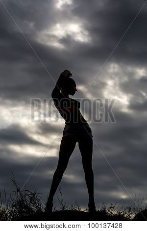 Female Silhouette On Sky Backdrop