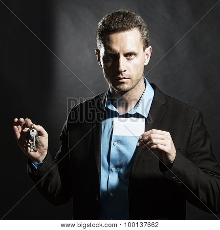 Man With Card And Keys Bunch