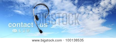 Contact Concept , Headset On Blue Sky, And Contact Us Text