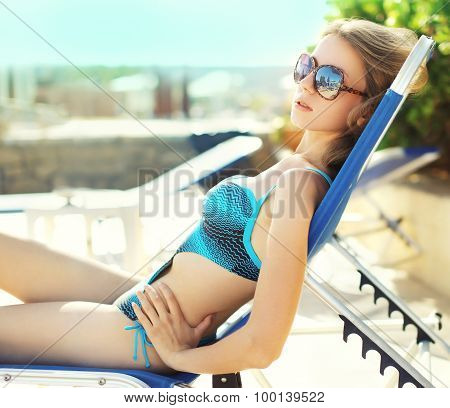 Portrait Of Beautiful Young Woman In The Swimsuit Relaxing On The Beach