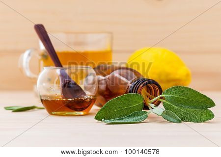 Cup Of Herbal Tea With  Fresh Sage ,honey And Lemon On Wooden Background.