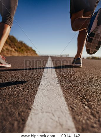 Runners On Middle Of The Road