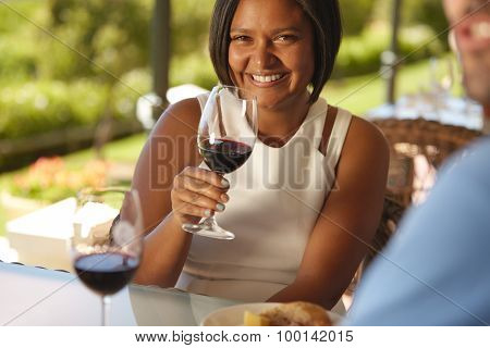 Beautiful Woman At Winery With A Glass Of Red Wine