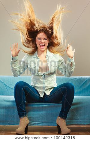 Fashionable Girl Wearing Denim Relaxing On Couch.