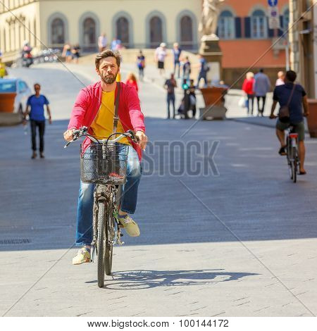 Cyclist near Bridge Santa Trinita, Florence, Italy