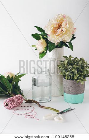Florist Preparation With Selection Of Vases Scissors And String