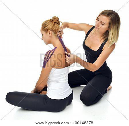 Doctor Physician Hands Applying Special Physio Tape On Woman