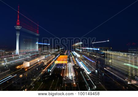 Motion Blur Background Of Auckland Financial Center Skyline At Night