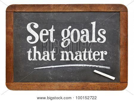 Set goals that matters - motivational advice  on a vintage slate blackboard