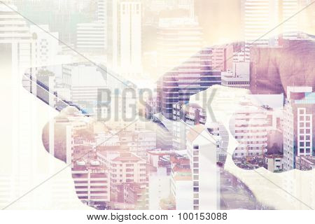Double exposure of man using a smart phone with a view of the city