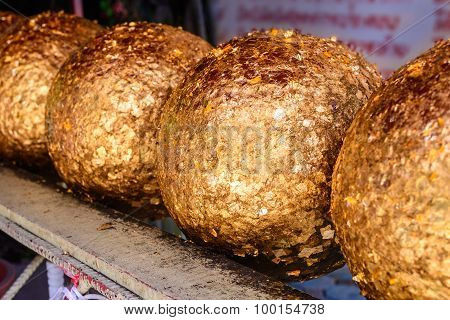 Loknimit, Round Stone Cover Thinly With Gold.