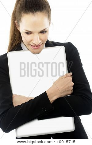 young businesswoman with laptop in arms on white background studio