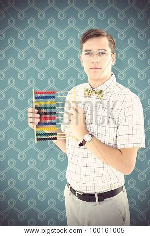 Geeky hipster holding an abacus against blue background