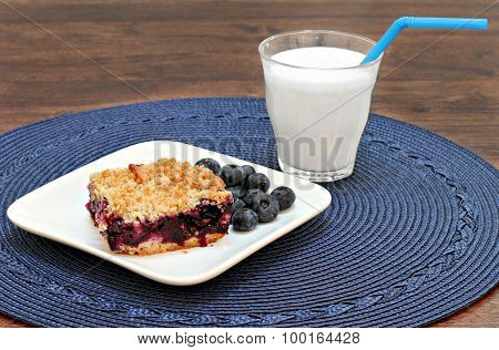 Blueberry Streusel Cookie Bars With A Glass Of Milk.