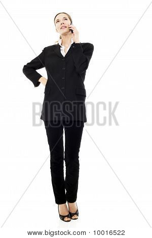 young businesswoman with mobile on white background studio