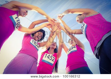 Five cheering runners supporting breast cancer marathon in parkland