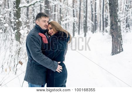 Portrait of happy couple in winter park