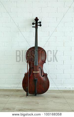 Cello on white brick wall background