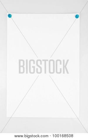 White sheet of paper attached on white background