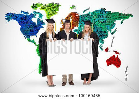 Three students in graduate robe holding a blank sign against white background with vignette