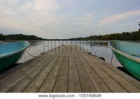 a smooth lake, pier, boat